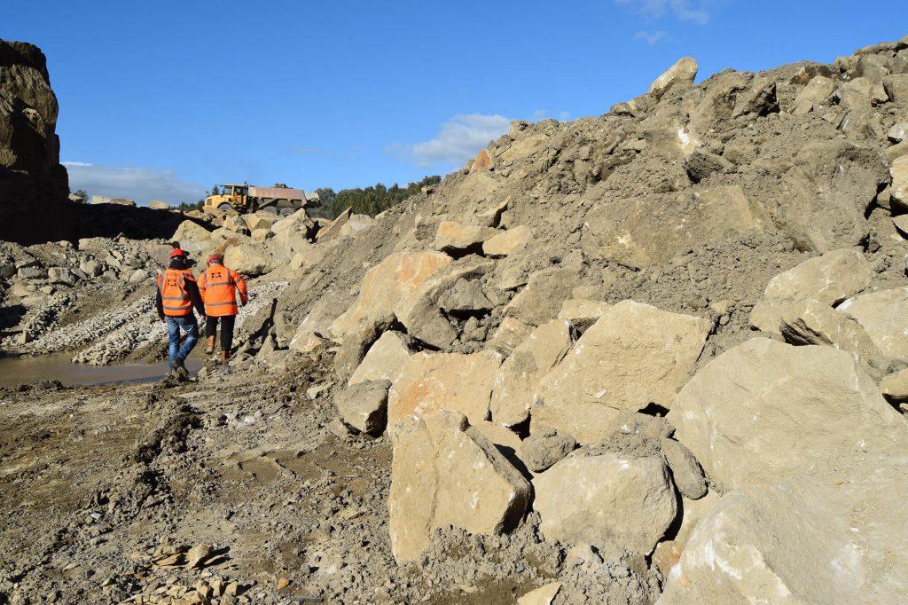 workers examine quarry