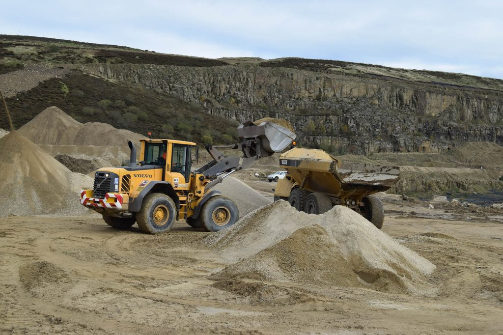 loading sand onto transport vehicle