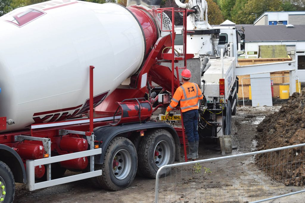 worker using concrete truck controls