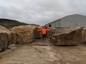 Image of our work experience student Thomas, from Bolton Sixth Form College, down at our stone yard.
